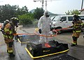 US Navy 090825-N-9573A-007 Firefighters wash down John Reece, from Harwich, Mass., in a decontamination station after using the Portal Shield Advanced Concept Technology (ACTD).jpg