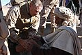 US Navy 091218-M-6770H-035 Lt. Cmdr. Bill Schalck, assigned to 3rd Battalion, 4th Marine Regiment, examines a local Afghan's knee during a combined medical engagement in Now Zad, Afghanistan.jpg