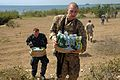 US Navy 100202-N-5700G-461 Service members arry water up a hill to an orphanage in Cabaret, Haiti.jpg