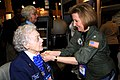 US Navy 100226-N-7863V-001 Helen Snapp receives a Navy pin from Rear Adm. Robin Braun at the 21st Annual Women in Aviation International Conference in Orlando.jpg