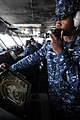 US Navy 100518-N-9132C-090 Operation Specialist Seaman Dale Jackson communicates from the bridge with all watch stations aboard USS Ronald Reagan (CVN 76).jpg