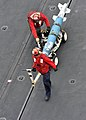 US Navy 110307-N-0569K-042 Sailors move ordnance aboard USS Enterprise (CVN 65).jpg