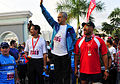 US Navy 110618-N-KB563-188 Dr. Jose Ramos-Horta, President of Timor-Leste, center, waves to the crowd as Capt. Jesse A. Wilson watches the start of.jpg