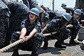 US Navy 110923-N-MW330-392 Seaman Brooke Haney, left, Seaman Recruit Travis Abankwah, and Seaman Recruit Dustin Davidson pull a line aboard the amp.jpg