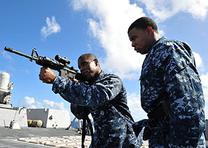 US Navy 120210-N-ED900-912 Personnel Specialist 1st Class Dwayne Smith, assigned to the guided-missile destroyer USS Pinckney (DDG 91), shows Opera.jpg