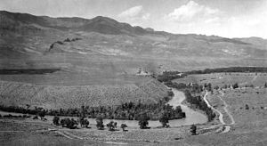 Fluvial terrace - Unpaired fluvial terraces on the South Fork of the Shoshone River, Park County, Wyoming, 1923.  The river at left has encountered a formation of erosion-resistant volcanic breccia, causing it to downcut more rapidly on the right, leaving terraces of different elevations.