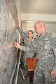 Utah Army National Guard Staff Sgt. Darrel Mock and Staff Sgt. Darrell Lewis, intelligence analysts, plot enemy positions on maps created by the National Geospatial-Intelligence Agency during an exercise 120415-D-ZZ999-031.jpg