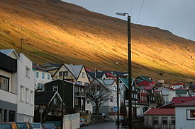 Vagur, Faroe Islands, in the winter, sunlight on slope.JPG