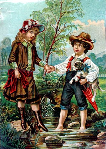 English: A boy helping a girl over a creek.