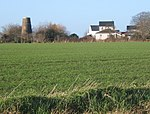 View across fields to disused windmill - geograph.org.uk - 649580.jpg