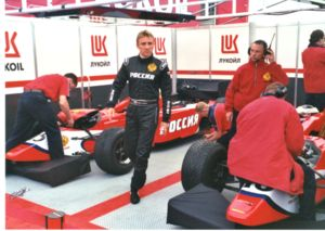 Viktor Maslov leaving the LUKoil Arden paddock during the 2001 Silverstone event.