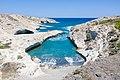 Volcanic rocks surrounding a small beach on Milos Island, Greece.jpg