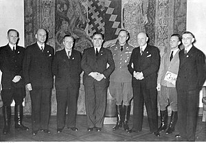 Deutscher Volksverband - Volksdeutsches decorated Golden Party Badge by Adolf Hitler in Berlin after Invasion of Poland in 1939. From left: Ludwig Wolff head of Deutscher Volksverband from Łódź, Otto Ulitz from Katowice, gauleiter Josef Wagner, mayor Rudolf Wiesner from Bielsko-Biała, obergruppenfuhrer Werner Lorenz, senator Erwin Hasbach from Ciechocinek, baron Gero von Gersdorff from Wielkopolska, Weiss from Jarocin.