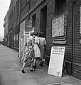 Voters arriving at a polling station in the Italian Hospital, Queen Square, Holborn, London to cast their vote in the General Election of 1945. D25102.jpg