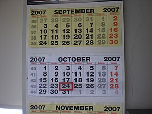 Calendar (stationery) - Wall calendar with moveable date marker