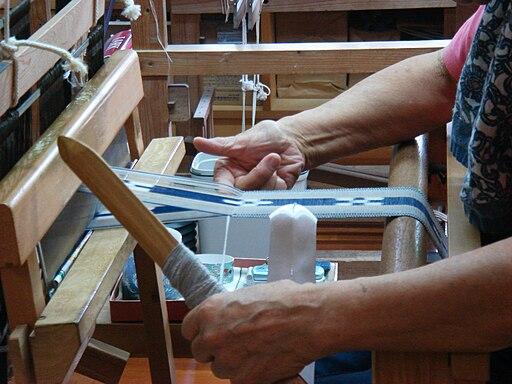 Weaving a MINSAH belt at Taketomi-jima Okinawa Japan