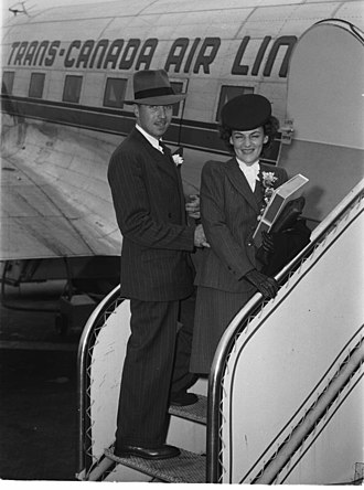 Honeymoon - Newlyweds leaving for their honeymoon boarding a Trans-Canada Air Lines plane, Montreal, 1946