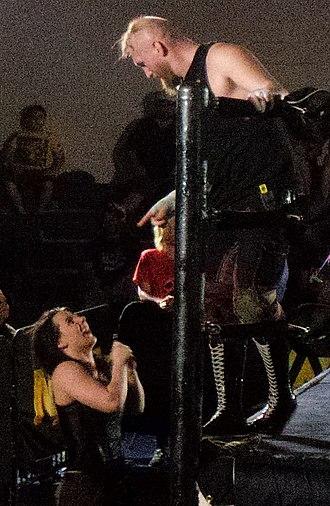 Alexander Wolfe (wrestler) - Wolfe (right) with fellow SAnitY member Nikki Cross
