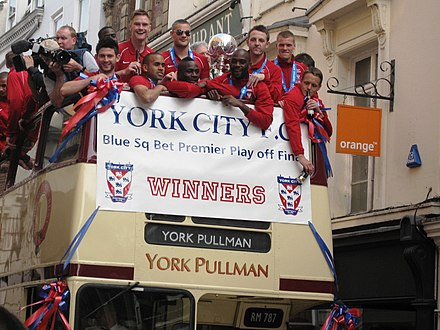 Celebrations following York's victory in the 2012 Play-off final York City open top bus 2012 01.jpg