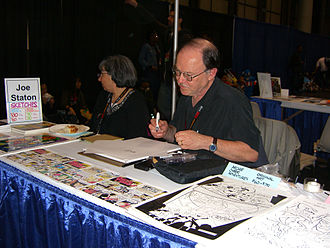 Joe Staton - Staton sketching at the 2011 New York Comic Con.