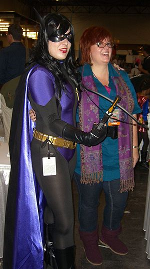 Gail Simone - Simone posing with a fan dressed as Huntress, a character whom Simone wrote in Birds of Prey, at the New York Comic Con, October 9, 2010.