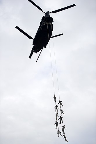 7th Special Forces Group (United States) - Soldiers from 7SFG(A) practice SPIE techniques from a MH-47 Chinook at Eglin AFB, February 2013