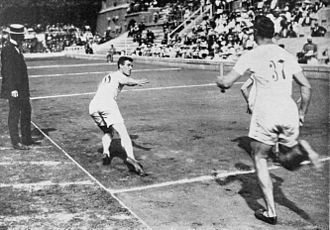 Athletics at the 1912 Summer Olympics – Men's 4 × 400 metres relay - The final: Edward Lindberg passing over the baton to Ted Meredith.
