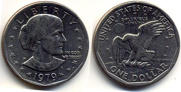 "US dollar coin, with the obverse side showing Susan B. Anthony, the words ""Liberty"" and ""In God We Trust"", and the year 1979; the reverse side shows the words ""One Dollar"", ""United States of America"", and ""E Pluribus Unum"", and an eagle carrying a laurel branch. 1 us dollar 1979.jpg"