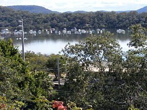 Brooklyn, New South Wales - Viewing NW over Hawkesbury River Railway Station showing moored vessels in Sandrook Inlet and Long Island (nature reserve) beyond.