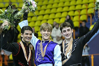 Tomáš Verner - Verner (center) with fellow medalists Stéphane Lambiel and Brian Joubert at the 2008 European Championships.