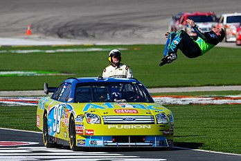Carl Edwards does his customary backflip following his third win of the season.
