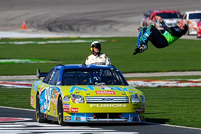 Edwards does a backflip, after winning at Texas Motor Speedway 2008 NASCAR Sprint Cup Series, Texas..jpg