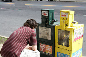 Bibliography of Boston - Man reading the Boston Globe in 2009