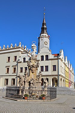 Reconstructed town hall and a plague column on main square