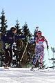 20130303 Biathlon Oslo 077 S Boilley (FRA) bekommt Getränk von M Bolliet.jpg