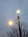 2014-12-20 16 51 56 Sodium vapor and mercury vapor street lights just after turning on along an alley adjacent to Winthrop Avenue in Ewing, New Jersey.JPG