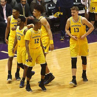 2016–17 Michigan Wolverines men's basketball team - The starting 5 (left to right): Zak Irvin, Derrick Walton, Muhammad-Ali Abdur-Rahkman (front), D. J. Wilson and Moe Wagner