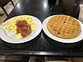 2018-07-21 06 21 04 Scrambled eggs, bacon and a waffle served as part of breakfast at the Ramada by Wyndham Rochelle Park Near Paramus in Rochelle Park Township, Bergen County, New Jersey.jpg