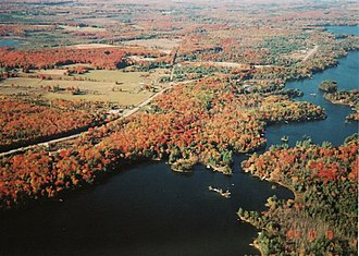 Ontario Highway 35 - Highway 35 north of Coboconk, showcasing the fall display. Shadow and Silver lakes are visible.