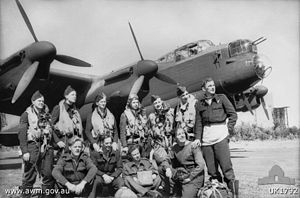 Aircrew and ground staff from No. 467 Squadron RAAF with one of the squadron's Lancaster bombers in August 1944