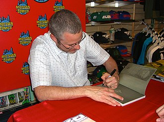 The Surrogates - Writer Robert Venditti signing a copy of The Surrogates Operator's Manual, which collects both miniseries, at Midtown Comics in Manhattan.