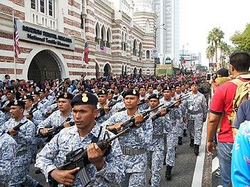 e79fdc3c27b3c Navy sailors wearing their blue black berets at 60th Merdeka Day Parade