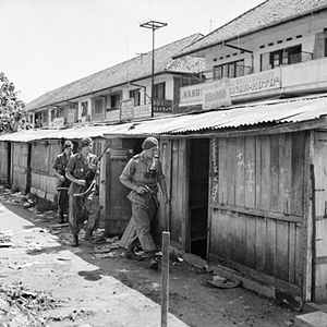 7th (Light Infantry) Parachute Battalion - Men of the 7th Battalion, Parachute Regiment, under Lieutenant S Dunsford, on patrol in the Kramat quarter of Batavia (Jakarta), December 1945.