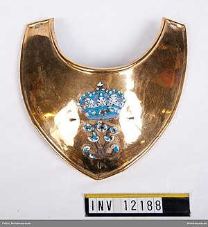 Gorget - Officer's gorget for majors and lieutenant-colonels of the Swedish Army, with the royal cypher of Frederick I of Sweden. Two palm branches, denoting rank, around the cypher has disappeared. Swedish Army Museum.