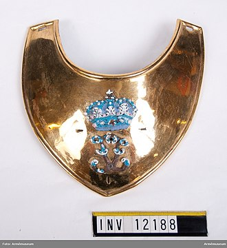Gorget - Officer's gorget for majors and lieutenant-colonels of the Swedish Army, with the royal cypher of Frederick I of Sweden. Two palm branches, denoting rank, around the cypher have disappeared. Swedish Army Museum.