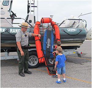 Amistad National Recreation Area - A law enforcement park ranger on National Junior Ranger Day at Amistad National Recreation Area's Diablo East Marina instructing young visitors about boating safety