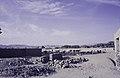 ASC Leiden - van Achterberg Collection - 14 - 05 - Une quarantaine de chameaux avec des chameliers - Oued Tamanrasset, Algérie - 1984.jpg