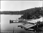 A Sydney Harbour scene with boatshed and dinghies (3506213113).jpg