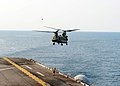 A U.S. Army CH-47F Chinook helicopter assigned to the 3rd General Support Aviation Battalion, 2nd Combat Aviation Brigade, 2nd Infantry Division prepares to land aboard the amphibious assault ship USS Bonhomme 140411-N-MK341-002.jpg