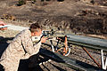 A U.S. Marine Corps scout sniper with Weapons Company, 1st Battalion, 1st Marine Regiment, 1st Marine Division conducts a distance range with Canadian and New Zealand service members during exercise Dawn Blitz 130612-M-SF473-044.jpg